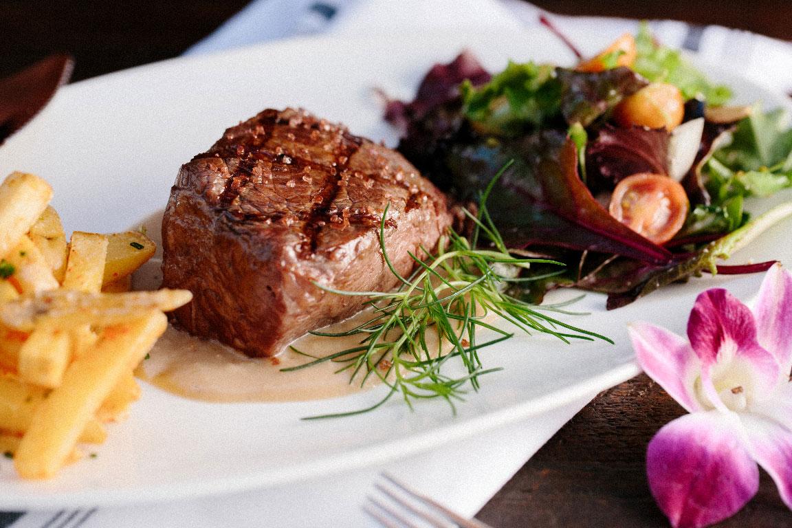 steak veggies and fries dinner plate